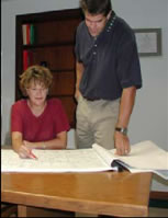 picture of two people reviewing engineering drawings